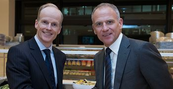Booker CEO Charles Wilson (left) and Tesco boss Dave Lewis shake hands on the proposed merger © Stephen Lock / i-Images/Tesco PLC