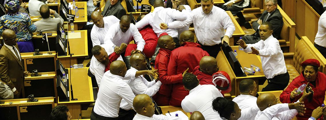 A fight broke out during president Zuma's address when security forcibly removed protesting MPs from an opposition party ©PA Images