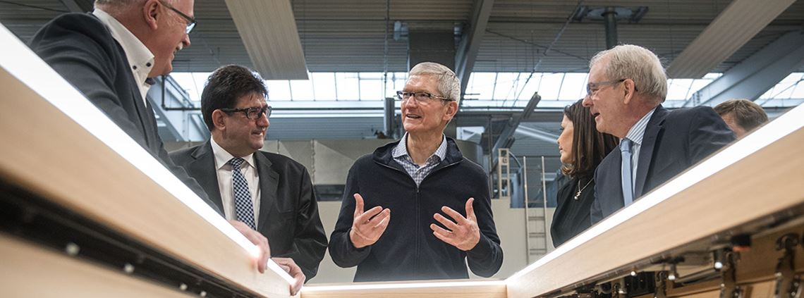 Tim Cook, pictured here examining Apple store furniture, wants the firm to be the ripple in the pond that creates job growth ©PA Images