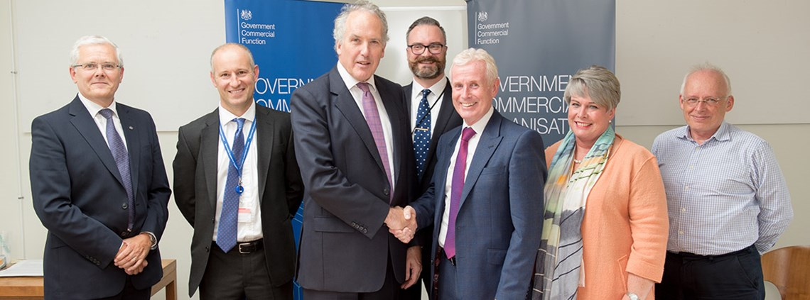 CIPS Group CEO Gerry Walsh (right) shakes hands with Gareth Rhys Williams © Charles Best