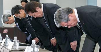 Akira Takeuchi (centre) along with his board of MMC's directors apologised to clients and stakeholders at a press conference in Tokyo © PA Images