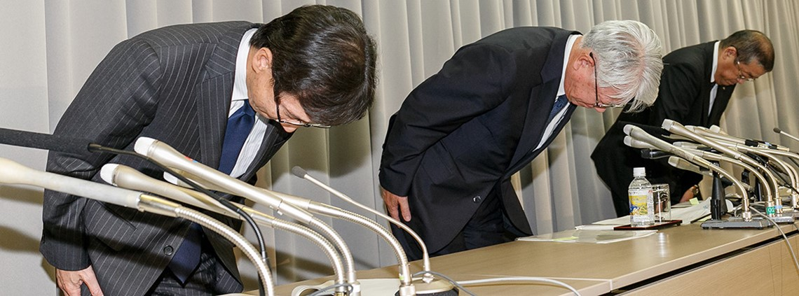 Kobe Steel's board of directors bow during a press conference after admitting data fraud © PA Images