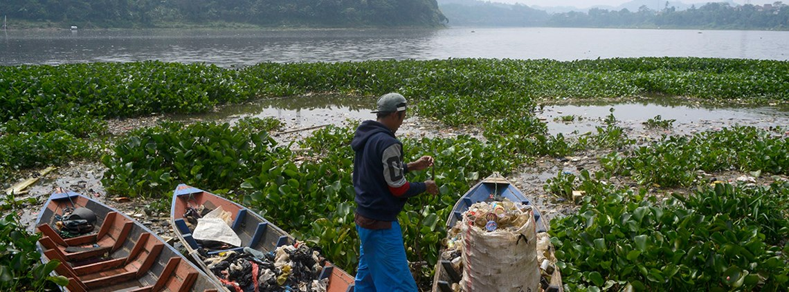 A man collects rubbish from the Citarum river in Indonesia © SIPA USA/PA Images
