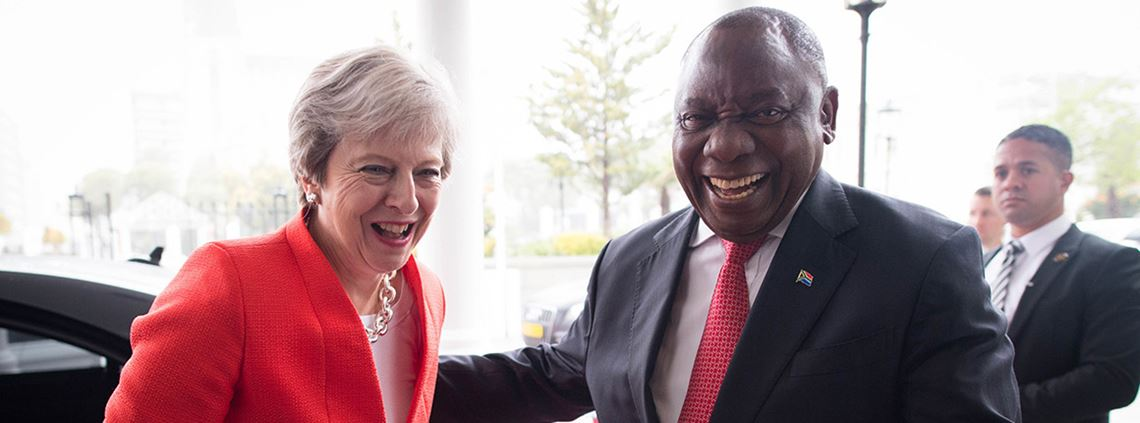South African president Cyril Ramaphosa greets Theresa May on the first day of her tour of Africa ©PA Images
