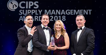 CIPS SM Awards overall winners Northumbrian Water (with the evening's host, comedian Russell Kane and Patrick Dunne of the judging panel) ©Alex Deverill