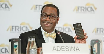 AfDB president Adesina holds the Maraphone at a launch event ©Mara Group