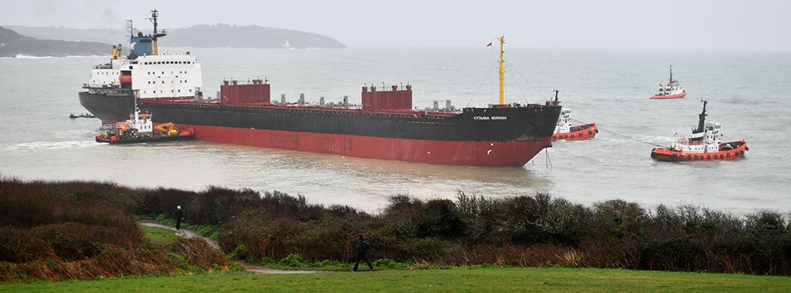 Tugs manoeuvre the Kuzma Minin, a 16,000-tonne Russian cargo ship, as attempts are made to refloat it after it ran aground off Gyllyngvase Beach in Falmouth. © PA Images
