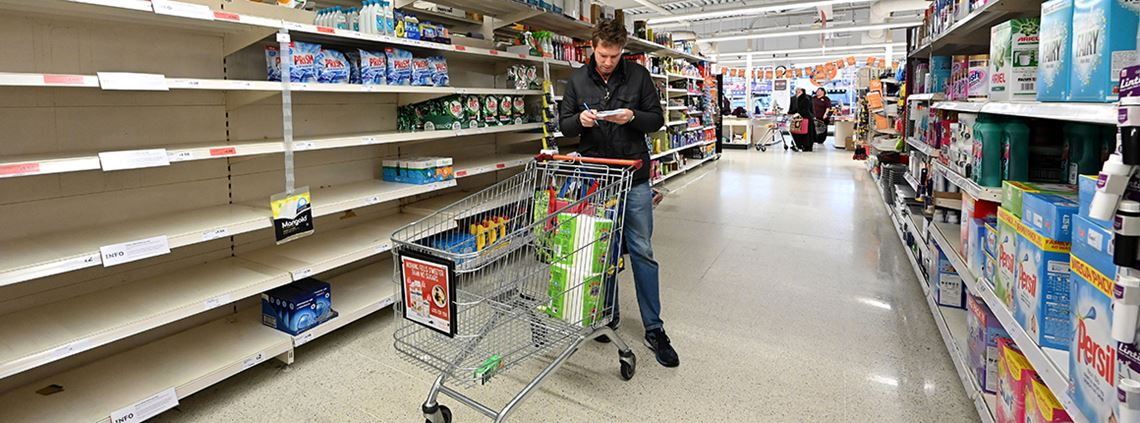 Products such as toilet paper and kitchen roll have sold out in many shops © AFP/Getty Images