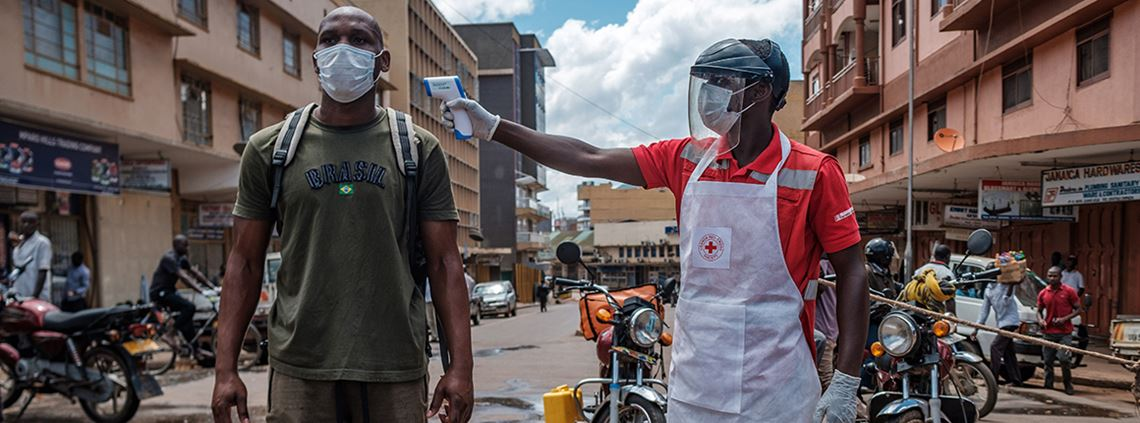 A man's temperature is checked before he can enter Nakasero market in Kampala, Uganda © AFP/Getty Images