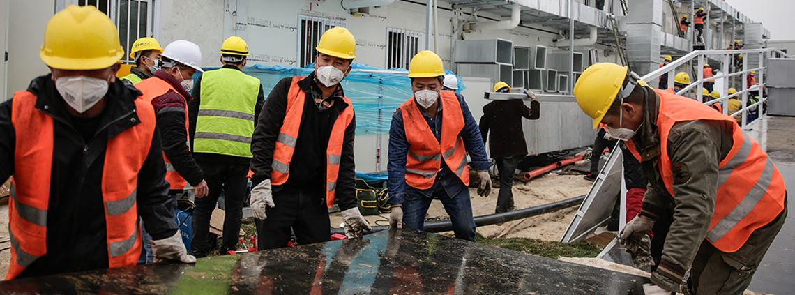Workers built a hospital in Wuhan in 10 days for Covid patients © Stringer/Anadolu Agency/Getty Images